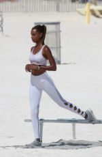 Jasmine Tookes Pose on set of a beach shoot for Victoria Sport in Miami