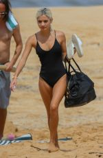 Pia Mia Wearing one piece swimsuit while cooling off in Waimea Bay