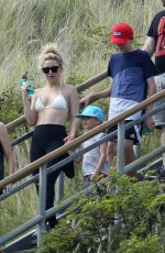Kate Hudson Climbing down to a beach with her family, on holiday in Honolulu