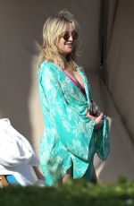 Kate Hudson In a bikini, partly covered, on vacation in Hawaii