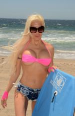 Angelique Frenchy Morgan Spends Memorial Day boogie boarding at Zuma Beach