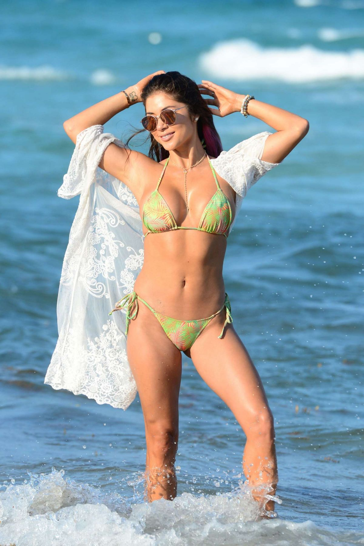 Arianny Celeste Splashes around in the sea while on the beach in Miami