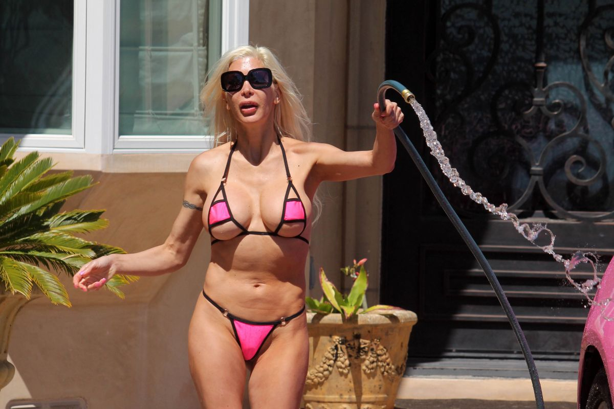Frenchy Morgan Is spotted in a tiny bikini washing her car in Malibu