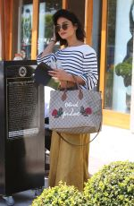 Vanessa Hudgens waiting for her car in West Hollywood