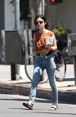 Lucy Hale Seen showing off her midriff and gucci belt as she gets a coffee in LA