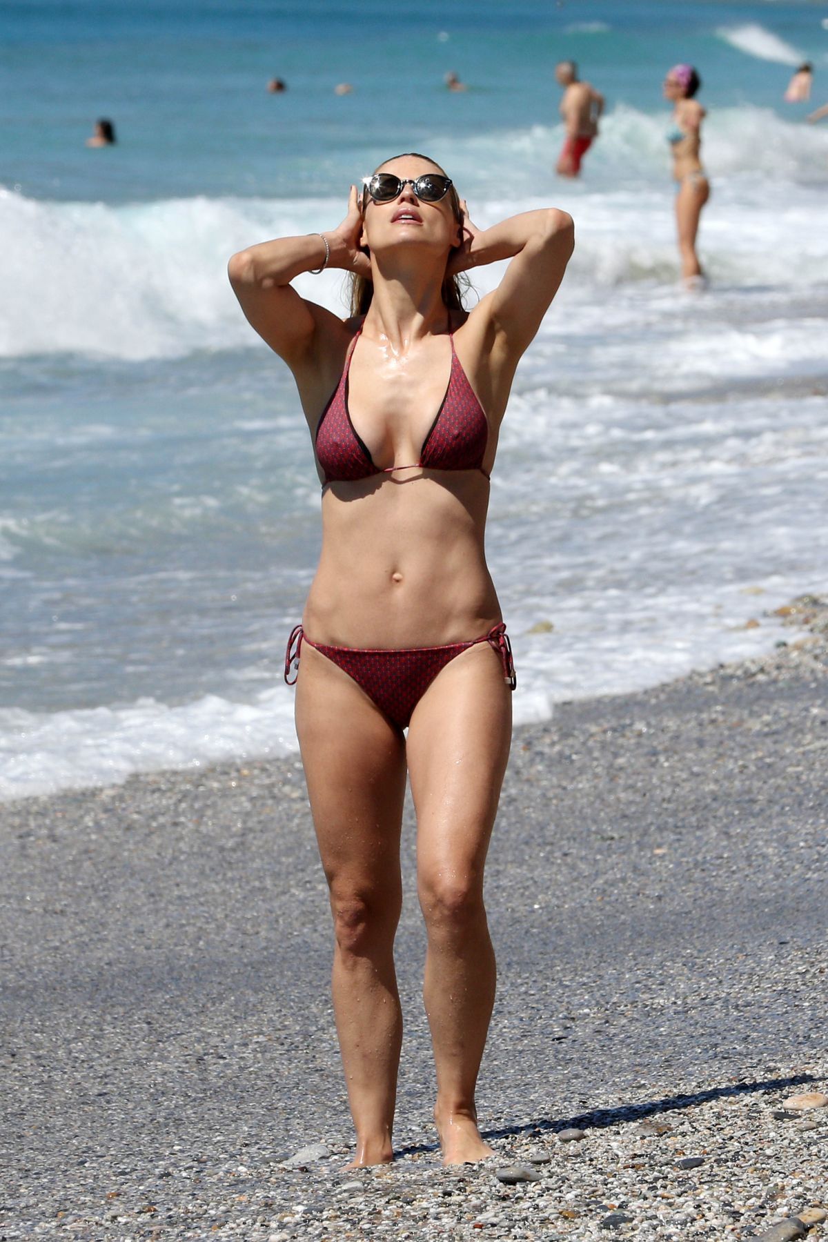 Michelle Hunziker Seen on the beach in bikini in Varigotti, Italy