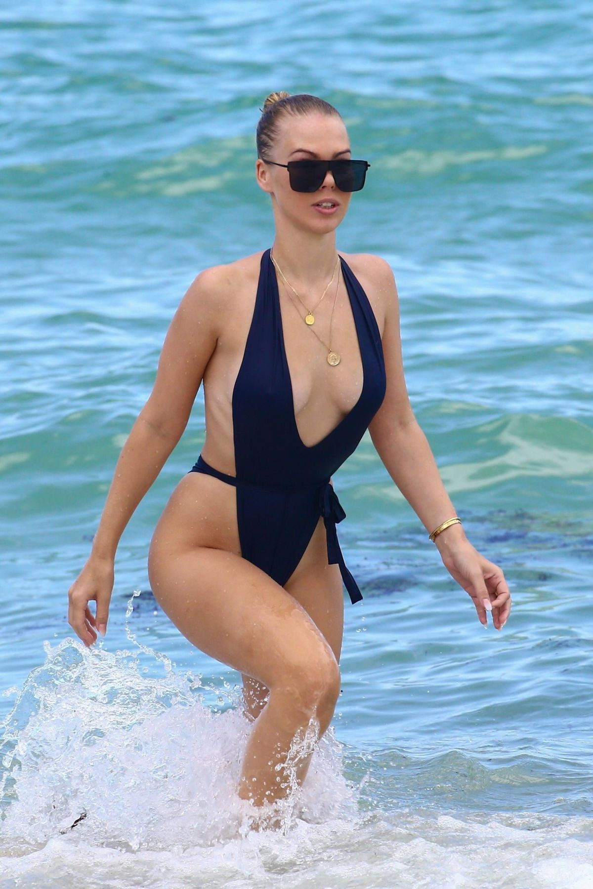 Bianca Elouise At the beach wearing a thong one-piece in Miami