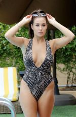 Chloe and Lauryn Goodman In Swimsuit at their Hotel Pool in LA