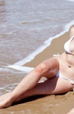 Ireland Baldwin In Swimsuits For All photoshoot