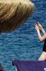 Lily Collins In Swimsuit on the Beach, Day 2 - Ischia, Italy