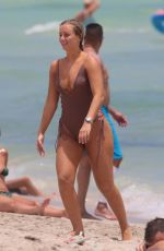 Cecilie Nordahl In a thong one piece swimsuit at the beach in Miami Beach, Florida