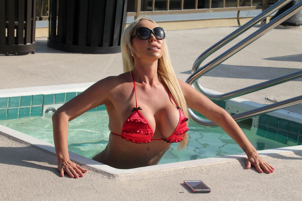 Mary Carey Showing off her great body in a bikini by the pool in Los Angeles