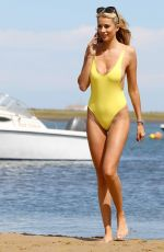 Olivia Attwood Wearing a yellow swimsuit whilst on holiday in Portugal
