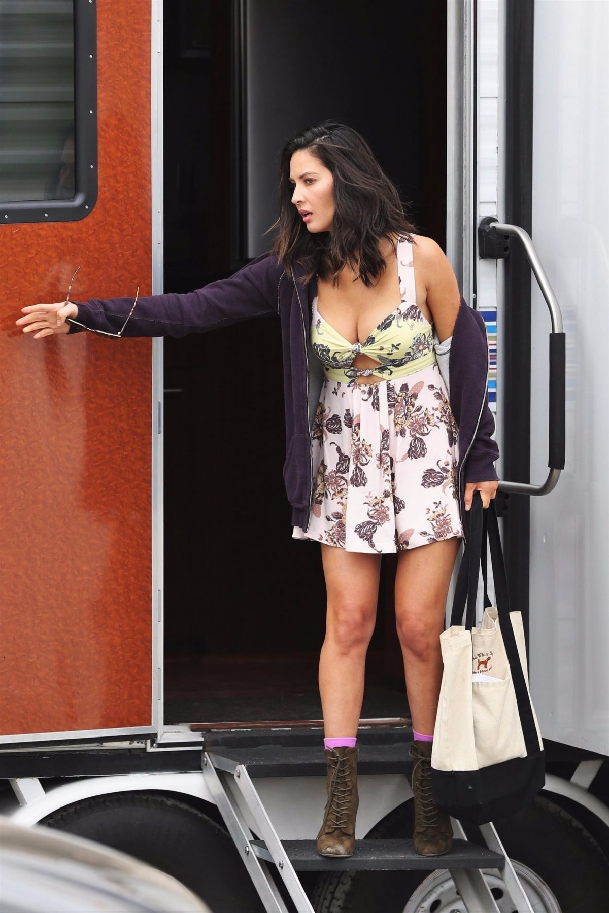 Olivia Munn Shows some cleavage in a low-cut floral print dress while on the 7bb41bdbf