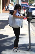 Roxy Sowlaty Pays a parking meter while out running errands,Beverley Hills
