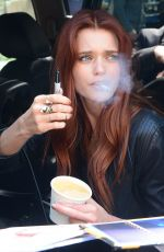 Abbey Lee Kershaw Smokes a cigarette as she signs for fans in Toronto