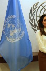 Angelina Jolie And Antonio Guterres are posing together at the United Nations Headquarter in New York City