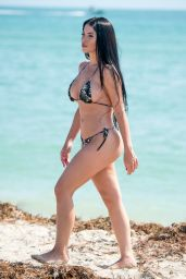 Claudia Alende aka Brazilian Megan Fox Spotted showing off her curves in a small army camouflage colored bikin in Miami