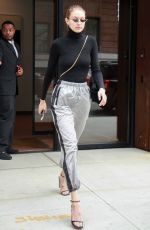Gigi Hadid Shows off her sporty side in silver workout pants and black turtleneck in NY
