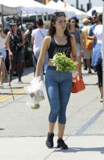 Isabelle Fuhrman Cameltoe at a farmers market and chats on her phone in LA