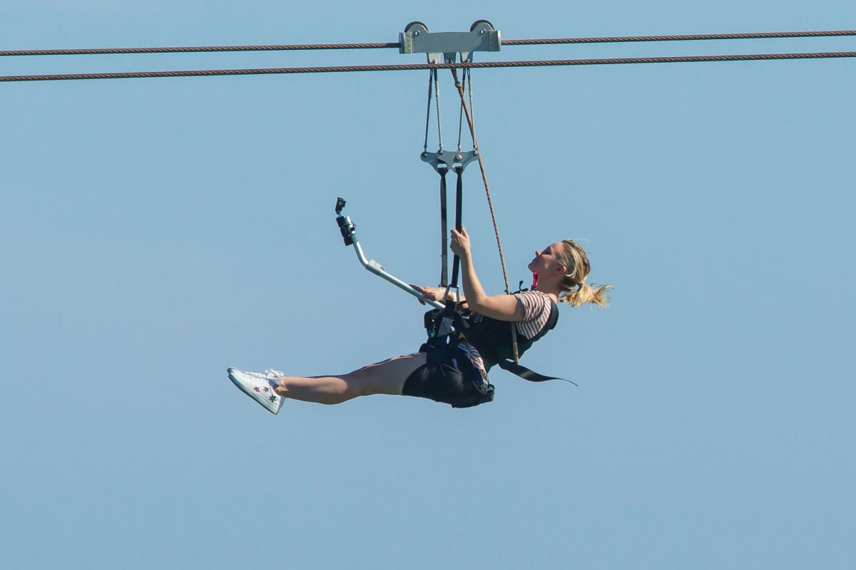 """Kristen Bell Going down a zip line in a scene for """"Like Father"""" in"""