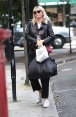 Zoe Ball Struggles with heavy baggage at the BBC studios	,London