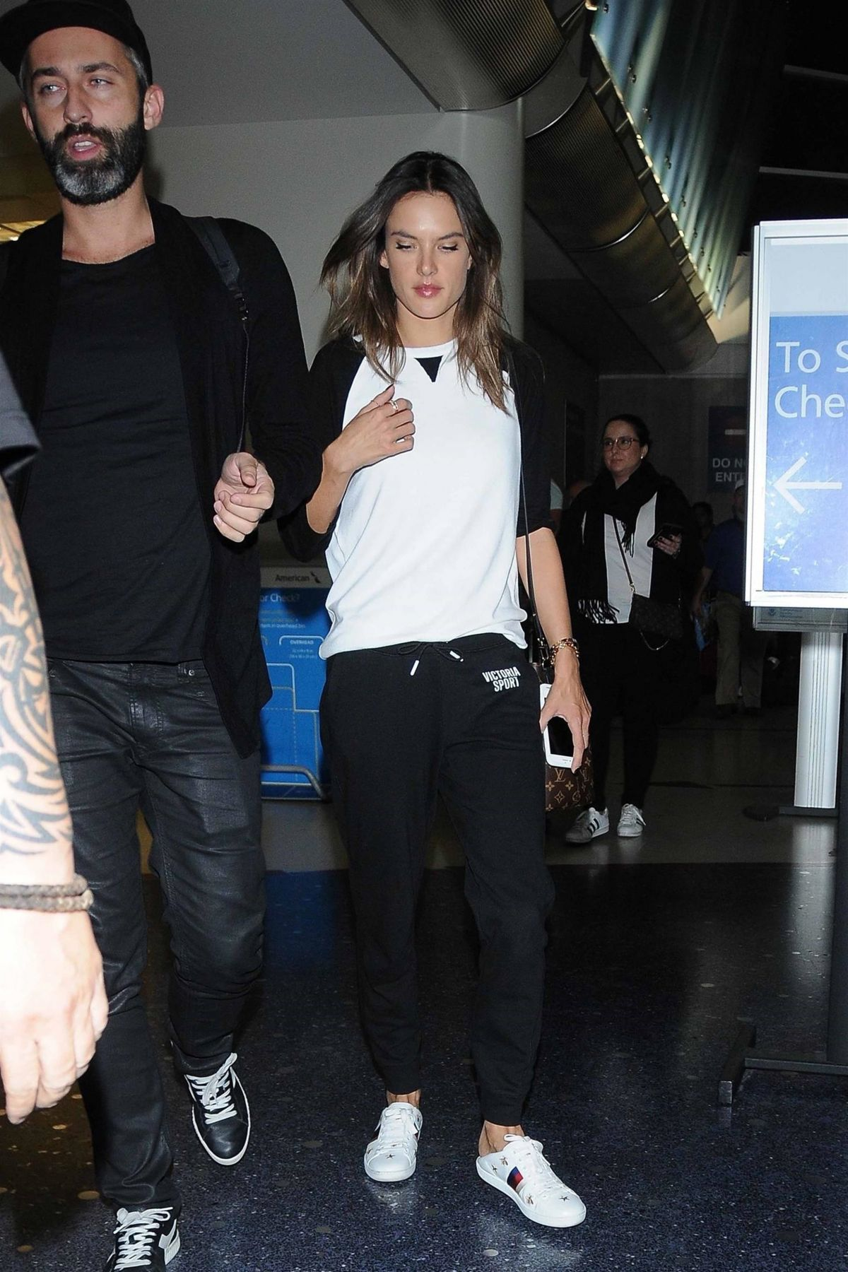 Alessandra Ambrosio Heads through airport after touching down at LAX International Airport in Los Angeles