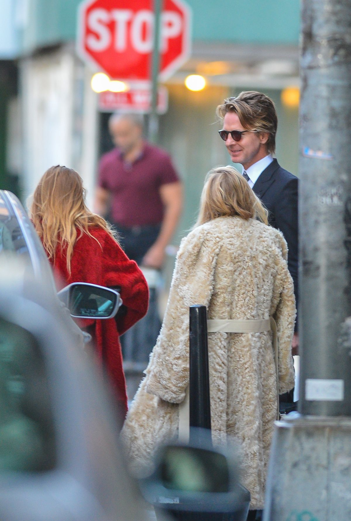 Ashley and Mary-Kate Olsen are spotted chatting with a mystery man in New York City