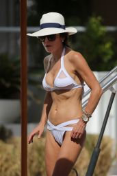 Bethenny Frankel Wears a sheer paneled white bikini top with a strappy white bottom in Miami Beach