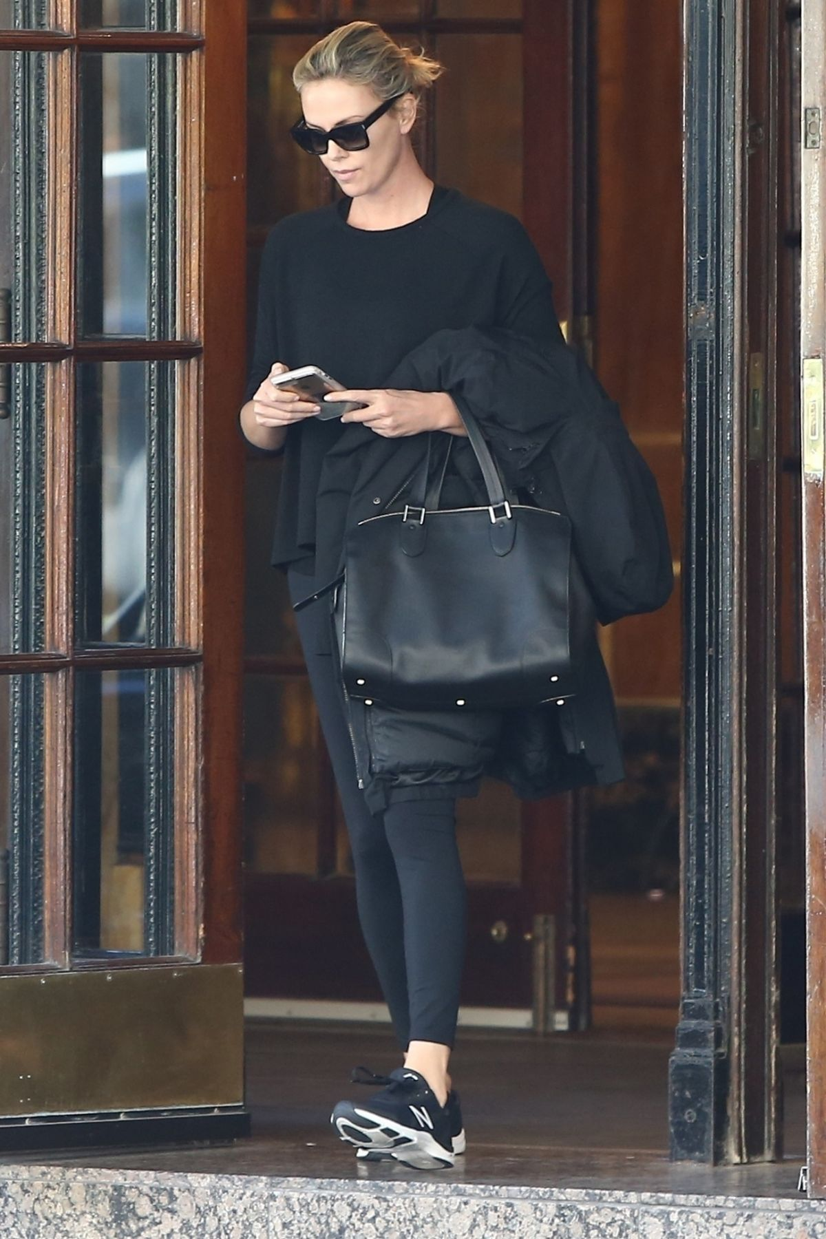 Charlize Theron Looks casual as she leaves her hotel in Montreal, Canada