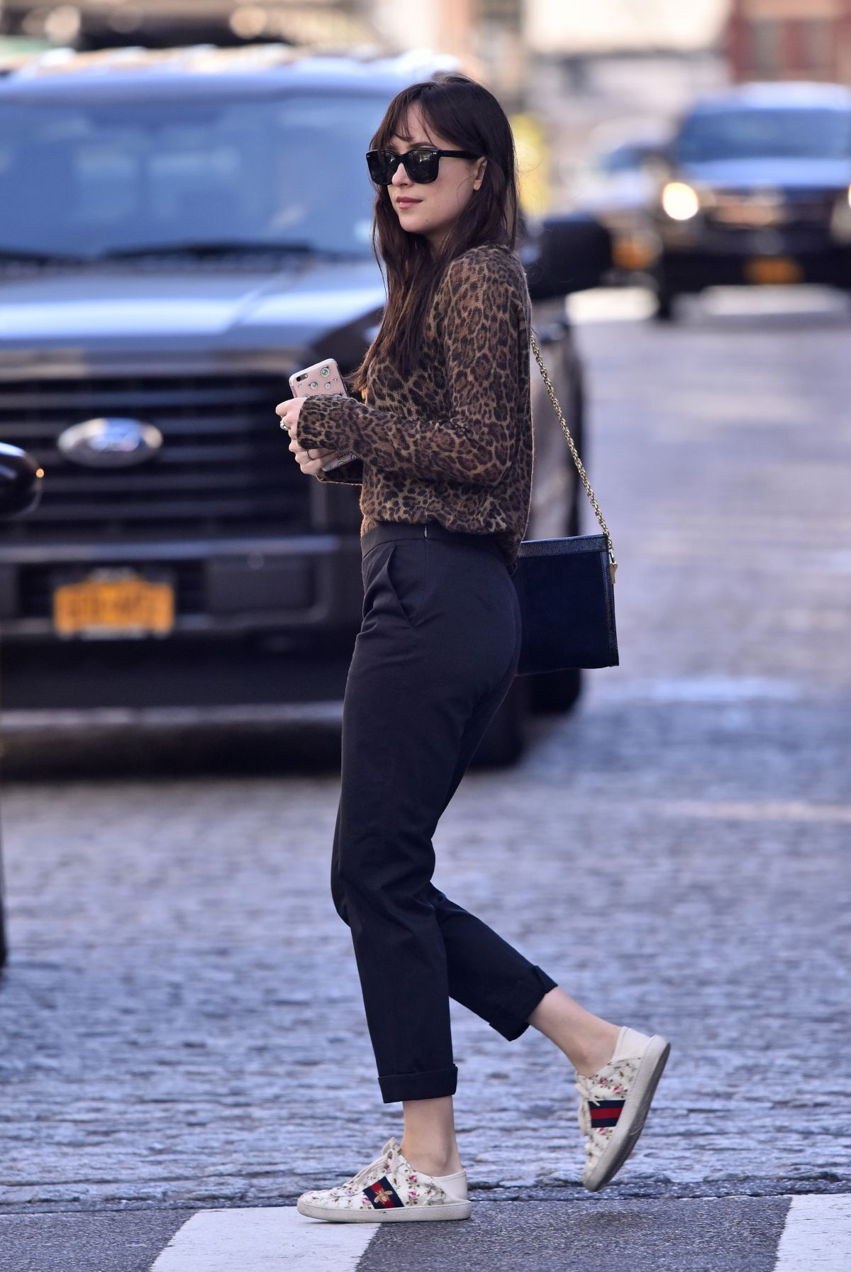 Dakota Johnson Wears A Leopard Top Paired With Gucci White