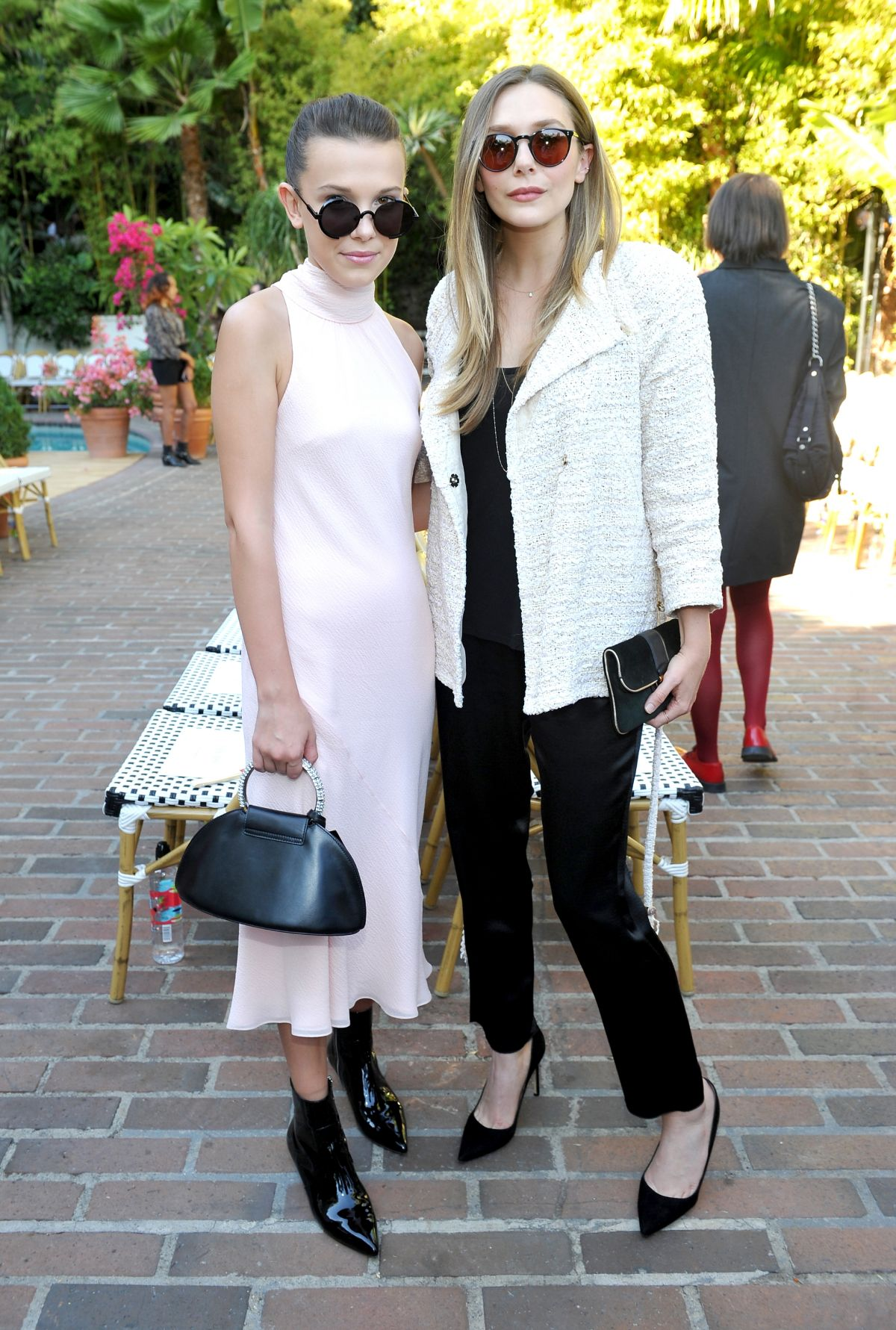 Elizabeth Olsen Attends CFDA/Vogue Fashion Fund Show and Tea at Chateau Marmont in LA