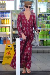 Jesinta Franklin Nearly suffers a wardrobe malfunction at a petrol station in a stylish red dress in Sydney