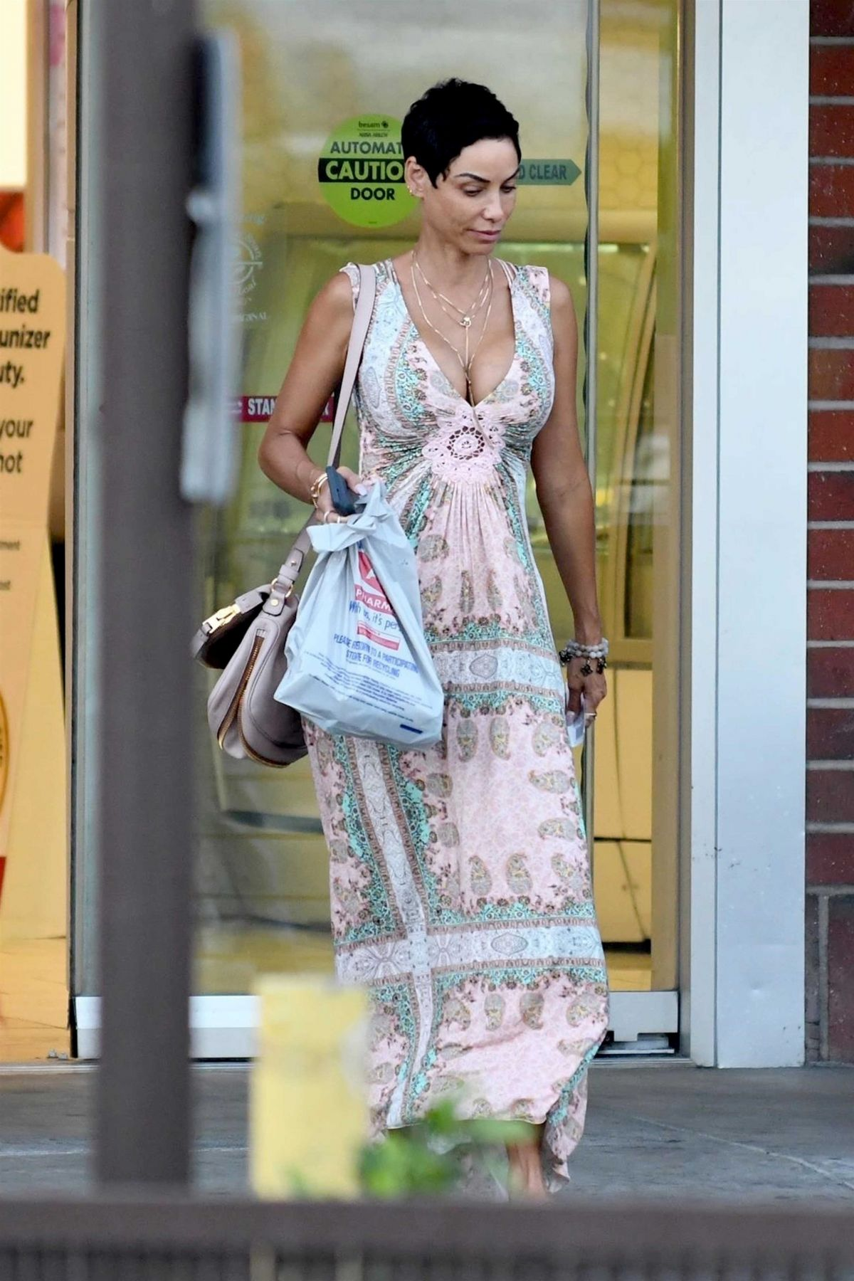 Nicole Murphy Was spotted showing plenty of cleavage in a floral print dress during a shopping trip to Rite Aid Pharmacy in Los Angeles
