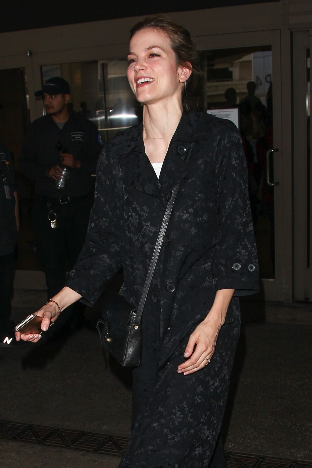 Sylvia Hoeks Greets some fans with a big smile as she arrives at LAX International Airport in Los Angeles
