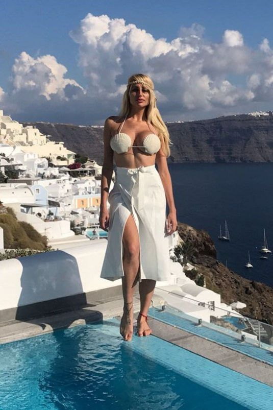 Victoria Xipolitakis In White top bikini at her vacation in Santorini, Greece