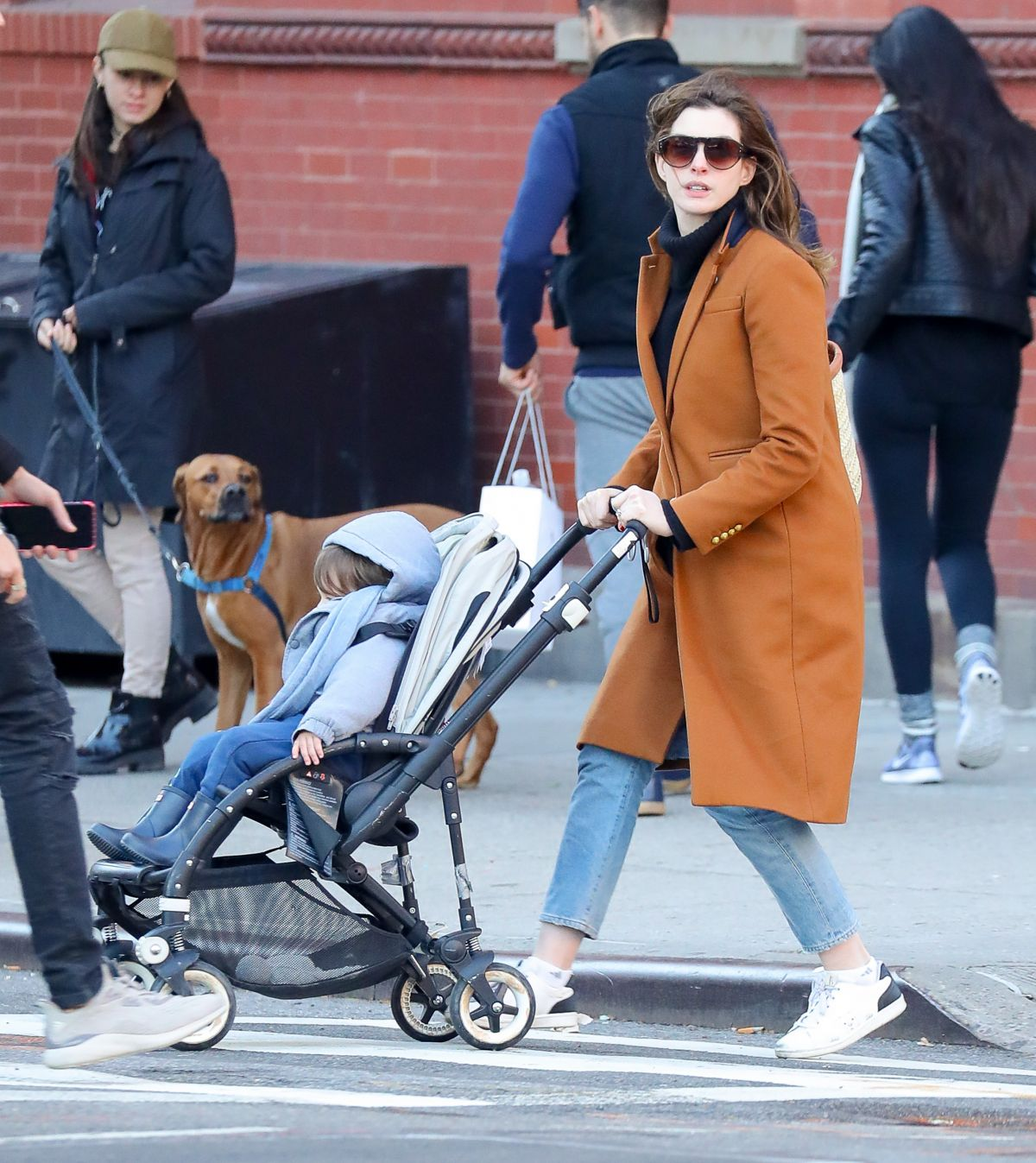 Anne Hathaway And Husband Adam Take Their Son To A