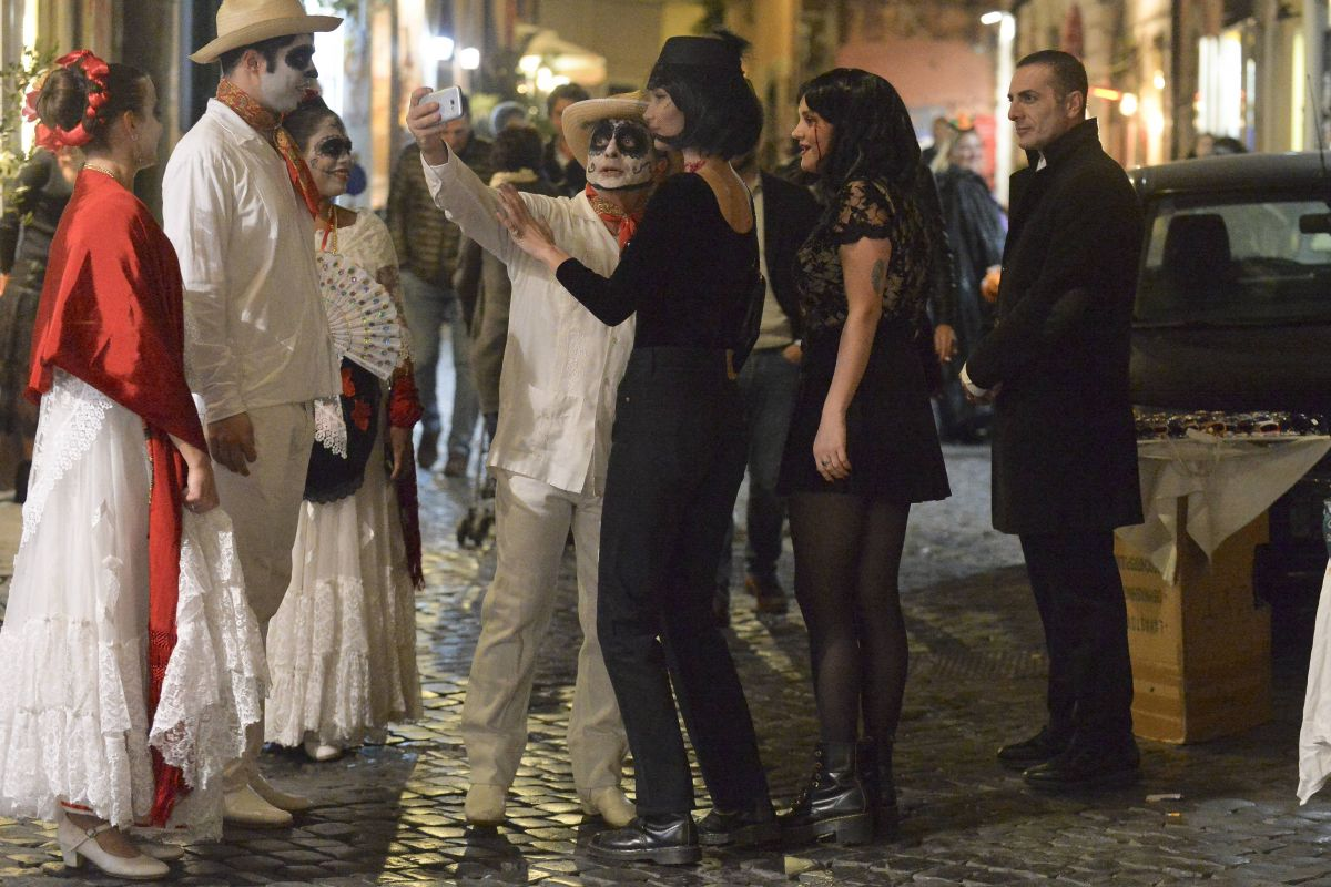 Bella Hadid Celebrates Halloween by cheering up with other people on the streets of Rome, Italy