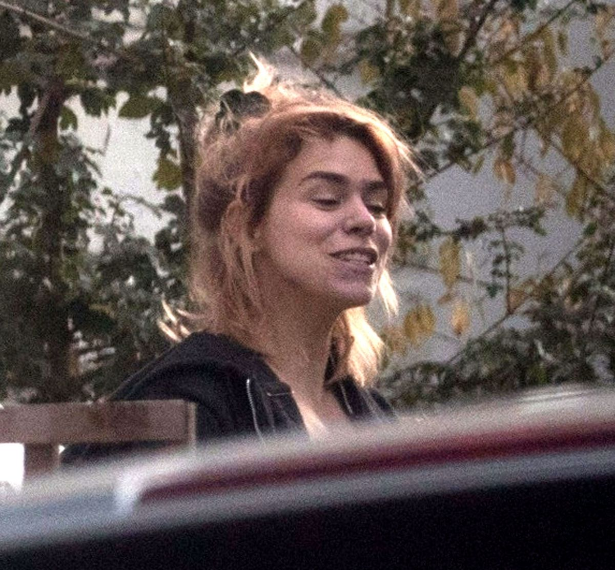 Billie Piper Is all smiles outside her home with her pet dog decorating her house, London