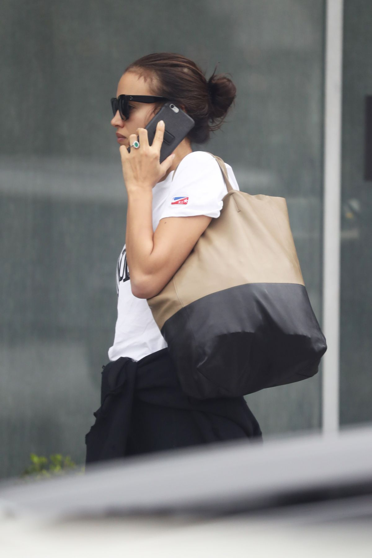 Irina Shayk Seen chatting on the phone arriving to her morning workout in Los Angeles