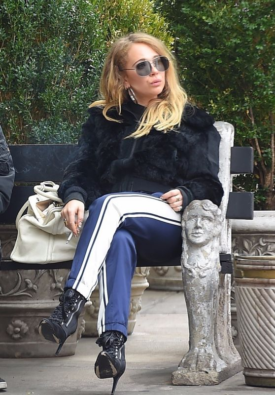 Juno Temple Was spotted taking a smoke break on a park bench outside of the Bowery Hotel in New York City