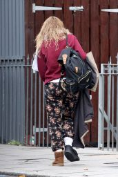 Lily James Is seen leaving her north London home wearing a protective boot on her foot with Matt Smith - London, UK