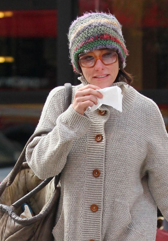 Parker Posey Sneezes and blows her nose, while out on a very windy and cold day in Manhattan