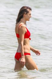 Alessandra Ambrosio Showing off her famous figure in a red bikini on the beach in Florianopolis