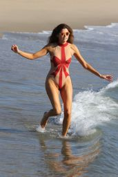 Blanca Blanco Gets into the holiday spirit at the beach in Malibu wearing a Christmas bow sheer swimsuit