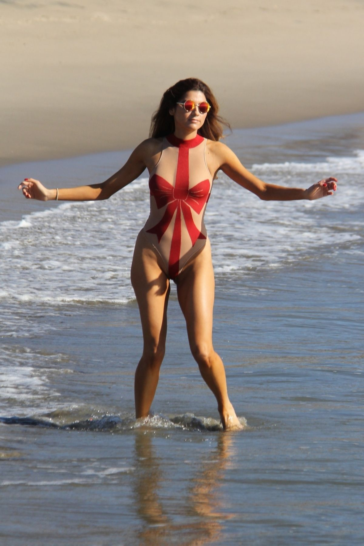 fb6471c4d2 Blanca blanco gets into the holiday spirit at the beach in malibu wearing a christmas  bow