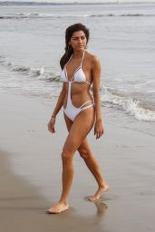 Blanca Blanco Shows off her curves in a white one piece swimsuit as she works on her tan on a gloomy day in Malibu
