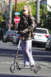 Charlotte McKinney Rides a Bird scooter around Santa Monica