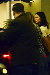 Courteney Cox Gets a helping hand from her bff Jennifer Aniston body guards after a long day of Christmas shopping in Beverly Hills