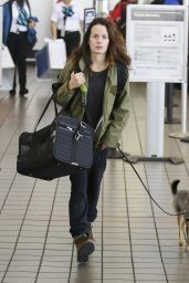 Elizabeth Reaser and her dog are seen arriving from a flight in Los Angeles, California